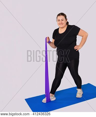 Smiling Athletic Large Woman Training Body At Home, Active Sports Workout. Fat Female Athlete In Act