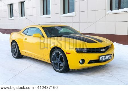 Novyy Urengoy, Russia - March 13, 2021: Yellow American Muscle Car Chevrolet Camaro V In The City St