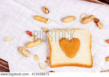 Homemade Toasts For Breakfast With Fresh Crunchy Heart Shaped Peanut Butter And Nuts On Light Textil