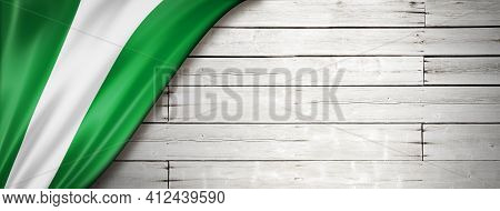 Nigeria Flag On Old White Wall. Horizontal Panoramic Banner. 3d Illustration