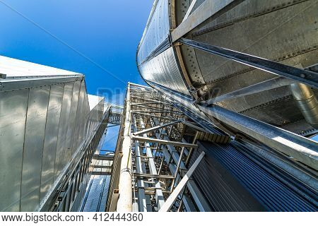Tanks And Agricultural Silos Of Grain Elevator Storage. Loading Facility Building Exterior. View Fro