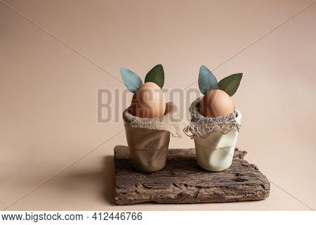 Zero Waste Easter Eggs Bunnies With Eucalyptus Leaves Ears And Natural Burlap Cloth In Ceramic Glass