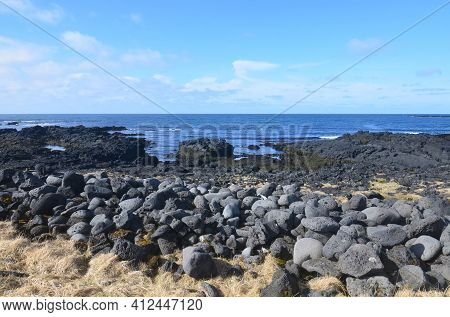Stunning Rural Rugged Black Lava Rock Along The Coast Of Iceland.