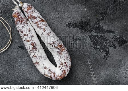 Dry Salami Sausage Fuet On Grey Textured Background, Flat Lay With Copy Space.