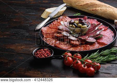Antipasto Platter Cold Meat With Chorizo, Fuet,salami, Salchichon And Longaniza On Dark Wooden Backg