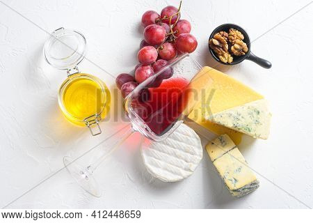 Antipasto Assortment Of Cheeses Red Wine Glass Camembert Dorblu Parmesan Organic White Textured Conc
