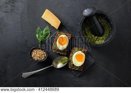 Fresh Green Basil Pesto Homemade On Old Rustic Wood Eggs Panini Bread With Pesto Silver Spoon On Ita