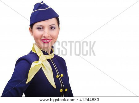 Beautiful young  smiling stewardess in uniform isolated on a white background