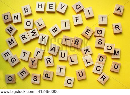 English Alphabet. The Letters Are Arranged Chaotically On A Yellow Background. View From Above. Word
