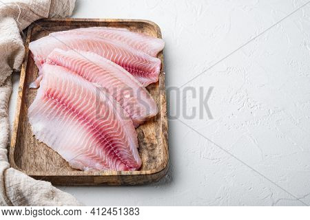 Tilapia Fish, Skinless Meat, On White Background With Copy Space For Text