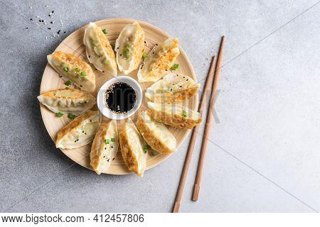 Gyoza Fried Chinese Dumplings On Bamboo Plate