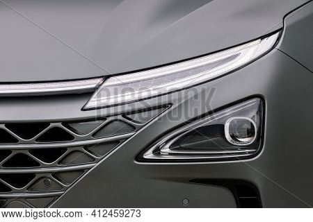 Front Light Of A New Grey Car
