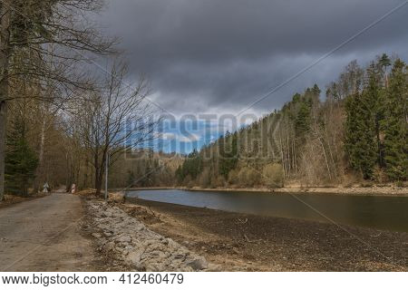 Vltava River In Valley North From Hluboka Town In Cold Winter Spring Day