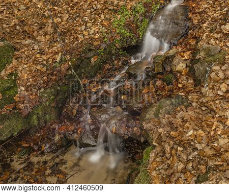 Small Creek With Waterfall Near Vltava River In Valley North From Hluboka Town