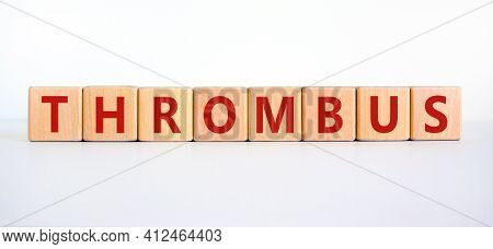 Medical And And Thrombus Symbol. Wooden Cubes With The Word 'thrombus'. Beautiful White Background.