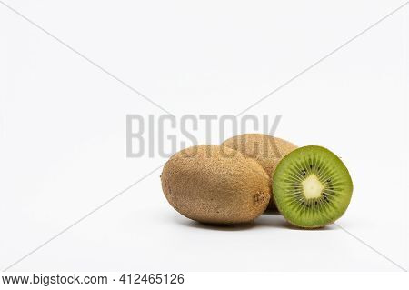 Kiwi Fruits Isolated On White Background, Two Whole Kiwi Fruit And Half Kiwi Fruit Isolated