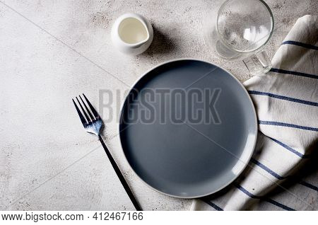 Elegant Empty Plate, Cutlery, Cup Of Coffee For Morning Eat, Light Table Background, Top View. Break