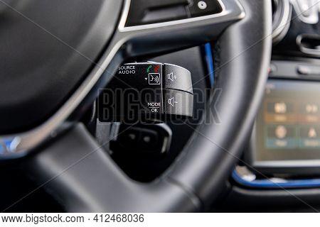 Audio Controls Below The Steering Wheel In A Car