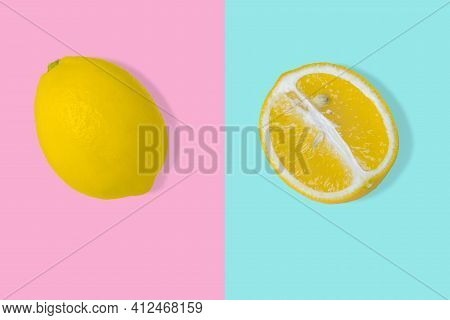 Trendy Summer Idea With Yellow Lemon Slice And Whole Fresh Lemon On Bright Pink And Blue Background.