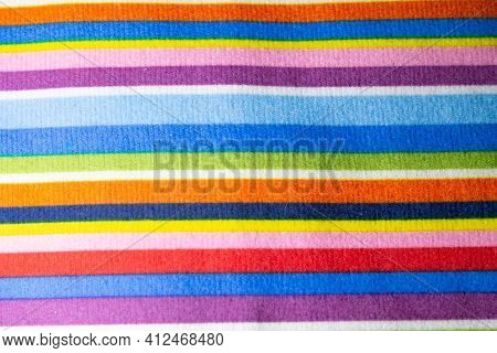 Fabric Texture With Multi-colored Stripes. Rainbow Fabric Texture. Colored Embroidery, Multicolored