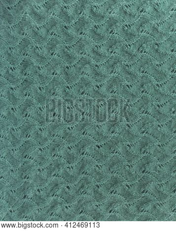 Pattern Abstract Knit. Close-up Of Knitted Wool Texture.  Pattern Knit As Background.
