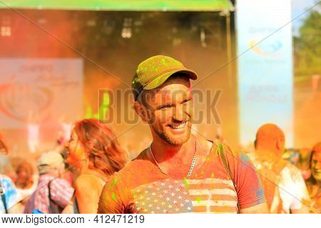 Young Cheerful Man At Holi Paint Party. Boy Celebrate Holi Festival, Is The Most Famous Festival In