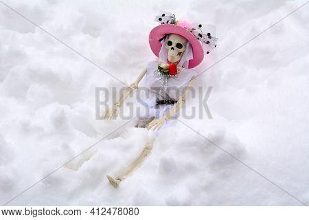 Skeleton In Fancy Pink Hat Getting Buried In Snow Storm