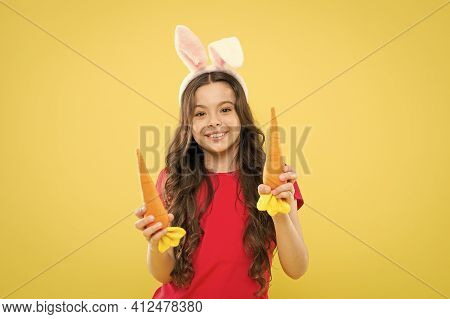 Spring Tradition. Child Bunny Ears. Diet For Health. Benefit Of Eating Carrot. Easter Carrot. Girl H