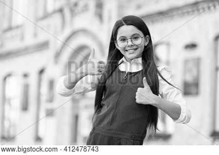 Happy Child In School Uniform Give Thumbs Ups Hand Gesture In Schoolyard Outdoors, Approval. Good Ed
