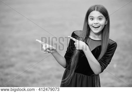 Look At This. Happy Girl Point Index Fingers Green Grass. Objective Pointing. Hand Gesture. Marketin