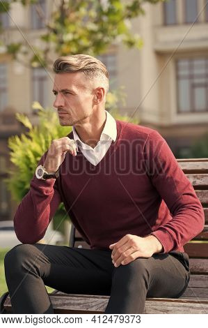 Every Man Needs Some Time For Himself. Handsome Man Relax On Bench Outdoors. Attractive Man In Casua