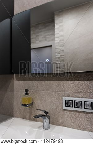 Modern Bathroom Washbasin With Chrome Faucet And Gray Tiling