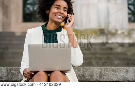 Business Woman Talking On Phone And Using