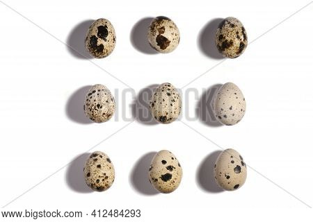 Creative Quail Egg Layout On White Background. Quail Eggs Pattern. Happy Easter Concept. Minimal Des