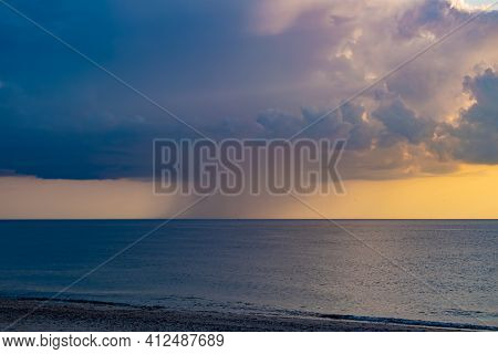 Rain Clouds Over North Sea, Denmark, With Windmills Visible Very Far Under Horizon Level