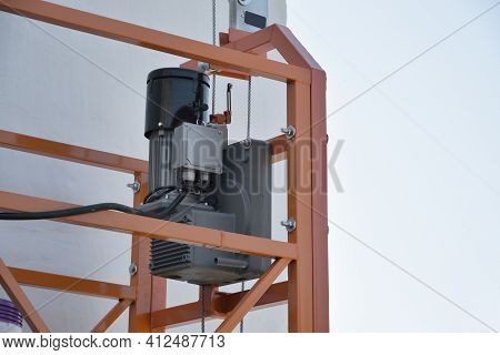 Hoist Supply And Safety Lock As Part Of Suspended Wire Rope Platform For Facade Works On High Multis