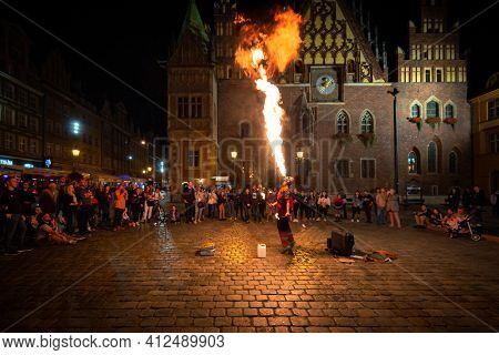 Wroclaw, Poland - September 6, 2020: Fire breathing show at the Old Town Square in Wroc?aw. Poland