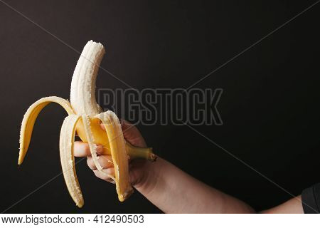 Woman Vegetarian Snacking With Banana, Free Space