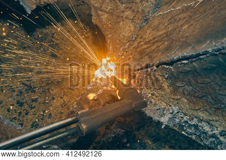 Top View Oxygen Acetylene Cutting Torch And Molten Metal And Sparkle In Vintage Tone