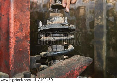 Car Mechanic Or Auto Mechanic Remove Upper Shock Absorber Nut And Ring Washer. Shock Absorber Remova