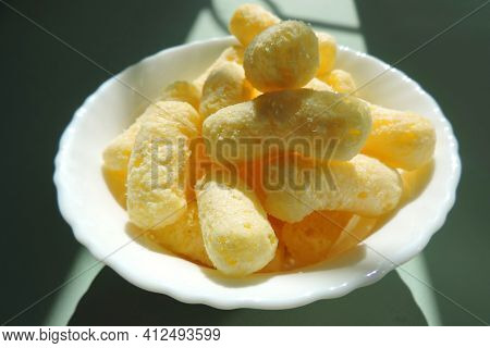 Crunchy Corn Snacks , Corn Sticks With Powdered Sugar, Contrast Of Sunlight And Shadow
