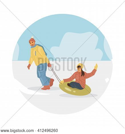 Active People In Winter City Park. Winter Time. Young Man Rolls Girl On An Inflatable Rubber Tube. C