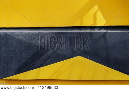 Abstract Geometric Black And Yellow Composition. Decorative Fragment Of The Exterior Of An Old Build