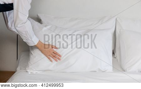 Hotel Room Service Hands Making Bed, Female Chambermaid Making Bed In Hotel Room