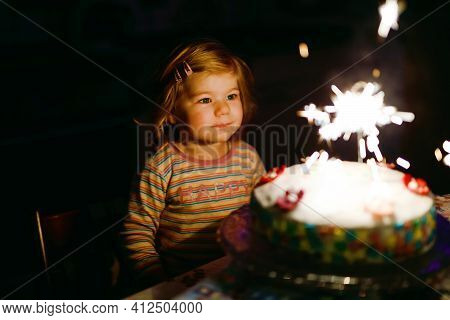 Adorable Little Toddler Girl Celebrating Second Birthday. Baby Child Eating Marshmellows Decoration