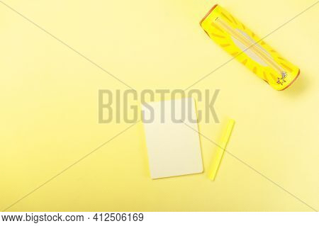 Yellow Notepad On A Yellow Table. Yellow Items. Yellow Office.