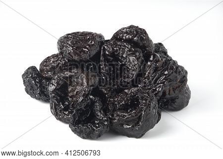 Heap Of Dried Prunes Isolated On White Background