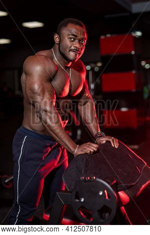 Pumped Up Shirtless African American Sportsman In Modern Gym With Up To Date Sport Equipment. Cute B