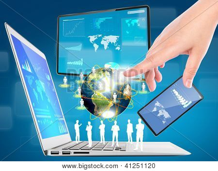 Business hand with laptop,mobile phone,touch screen device (Elements of this image furnished by NASA)