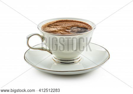 Black Coffee Served In A Porcelain Cup On An Isolated White Background